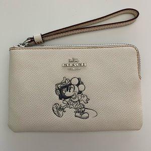 Coach Disney wristlet with Minnie Mouse motif